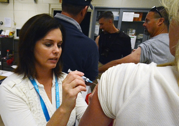 Tiffany Shadle administers a flu shot